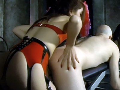 Asian Dominatrix Suki makes her male sub lie over the bench and smacks his bare bottom raw